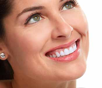 Image of lady smilling with having brighter & white teeth