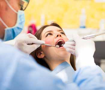 Image of a Dentist examine a Patient's Mouth