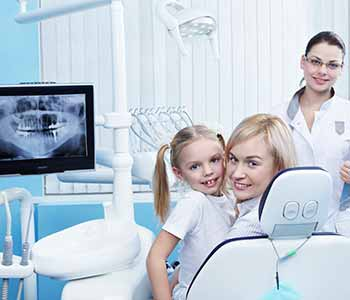 General Dentistry Waterloo ON Family Dentist A smiling family with healthy teeth